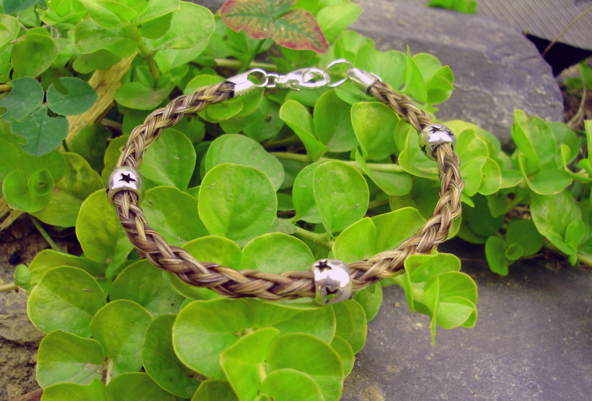 This custom horse hair bracelet includes sterling silver star beads. They really make the bracelet glow.