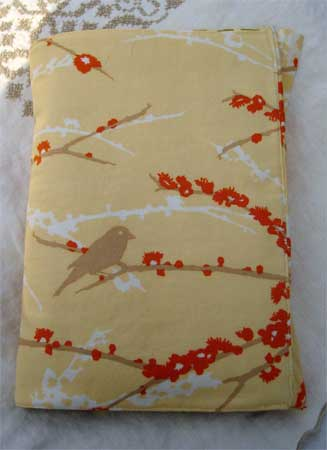 The outside of the journal cover featuring bird and cherry tree silhouettes.