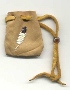 A feather quilled on a leather pouch using the stitches taught in the Porcupine Quillwork Part 2 Class.